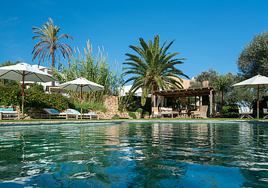 Have a refreshing swim at the pool of Es Cucons Hotel Ibiza