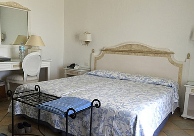 Comfortable rooms at Sardinia Beach Front Yoga Retreat offered by Spa In Spain