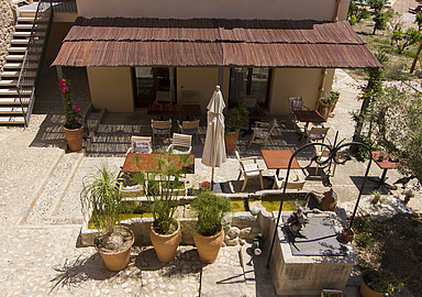 Enjoy home made healthy food at the outside tables of The Pink Pepper Tree Mallorca