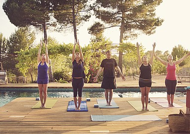 Morning yoga session with sunshine next to the pool at Yoga Retreat MasQi, Spain