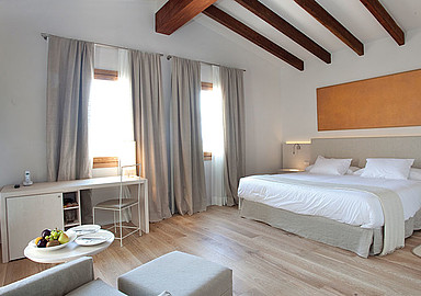 Example of a comfortable, bright and modern room at Font Santa Hotel