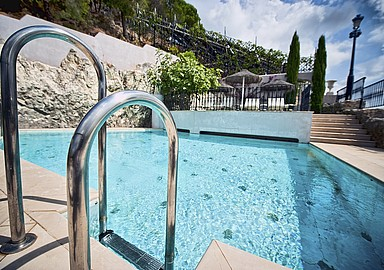 Sunny pool in your detox program at Villa Padierna Termas Hotel, Spain