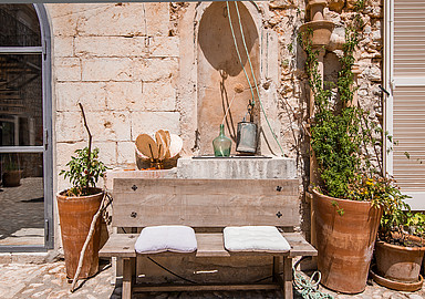 Welcoming and rustic patio of wellness hotel The Pink Pepper Tree in Mallorca