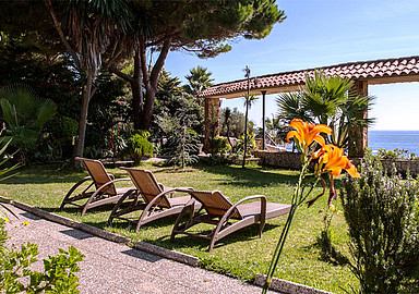 Relax in the lush gardens of Ayurveda Hotel Port Salvi, Spain
