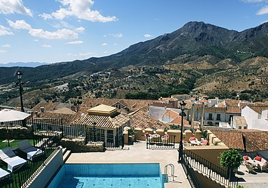 Relaxing with the views at the pool at Villa Padierna Termas Hotel, Spain