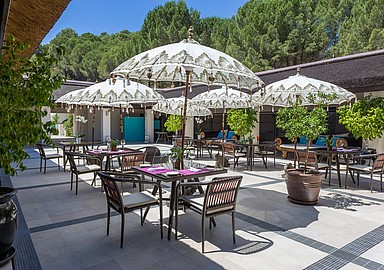 Cosy and charming patio at wellness hotel Shanti Som in Spain